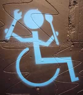 tool_wielding_wheelchair_user.jpg